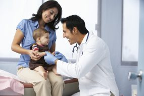 Mother, child, and doctor sitting in a doctors office