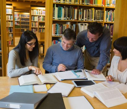 Group of people working together in a library