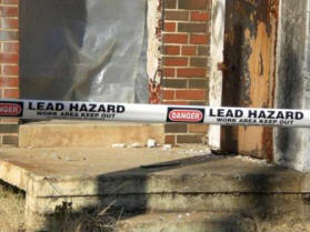 """Danger: Lead Hazard"" tape stretched across a work area"
