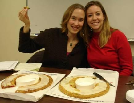 Harvard graduate students, Rebecca Lincoln and Melissa Ekstrand enjoy Kringle bread, which is native to Racine, Wisconsin.