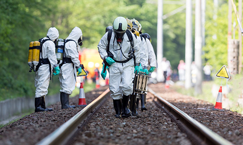 Toxic chemicals emergency team working on a railroad track