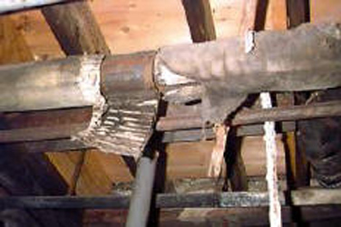 Figure 12.6. Heating Ducts Covered With Asbestos Insulation
