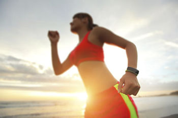 Image of woman exercising with smartwatch on wrist
