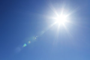 Image of sun in blue sky