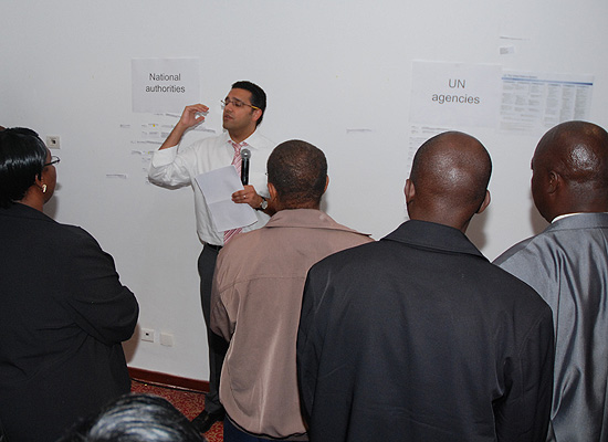 Altaf Sadrudin Musani, World Health Organization, working with group at training in Tunisia
