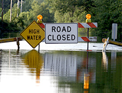 flooding on road with road closed sign