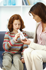 Mom giving treating young girl's asthma