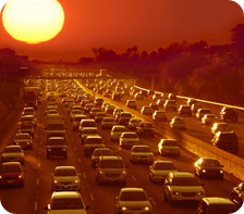 hazy sunset over traffic jam