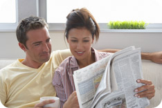Couple reading a newspaper together