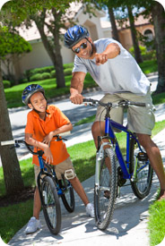 A boy and his father riding bikes