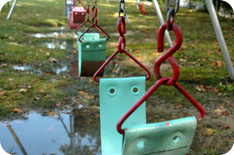 Row of swings on a playground