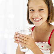 Young girl holding glass of water