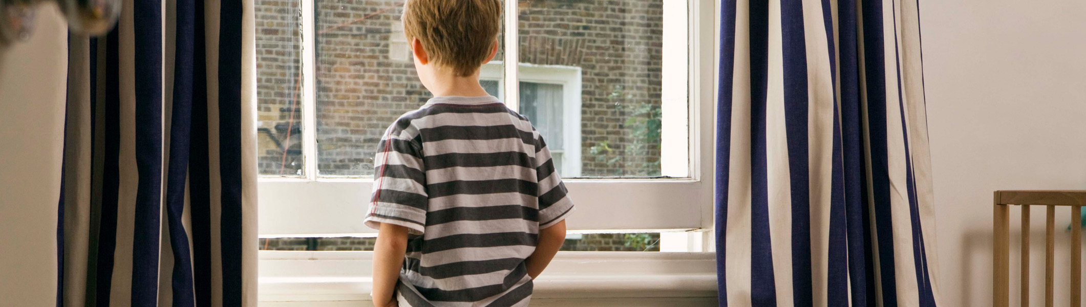 Young child looking out of window