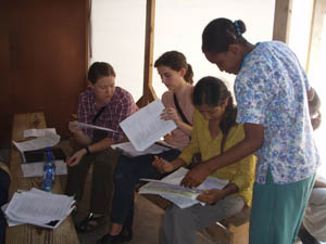 Photo: CDC staff reviewing patient charts during the cholera epidemic in Haiti
