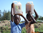 Household Water Treatment - boys carrying water in Africa