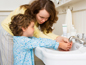 Hygiene - picture of mom teaching child how to wash hands