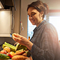 woman looking at food in delivery meal kit box