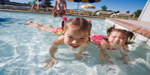 Photo:  Kids swimming in pool