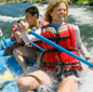 Photo: Group of people rafting down river