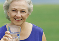 Photo: Older Lady Drinking Water from Glass
