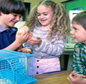 school children playing with pet hamster