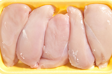 Photo of raw chicken breasts.