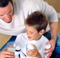 Photo: Father and Son with glasses of milk
