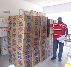Boxes of soap are ready in a warehouse in Cameroon. One bar will be given to each person who receives the oral cholera vaccine, along with instructions on the importance of handwashing to prevent disease.