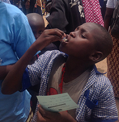 A young boy takes a dose of the oral cholera vaccine distributed in his village in northern Cameroon.