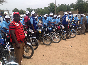 Community health workers use motorcycles to travel to different villages, where they will distribute the oral cholera vaccine door-to-door.
