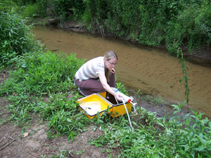 Water sample collection during an investigation of cryptosporidiosis at a summer camp