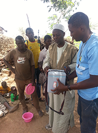 A community leader explains oral cholera vaccine distribution to a community in Mogode Health District in the Far North Region of Cameroon.