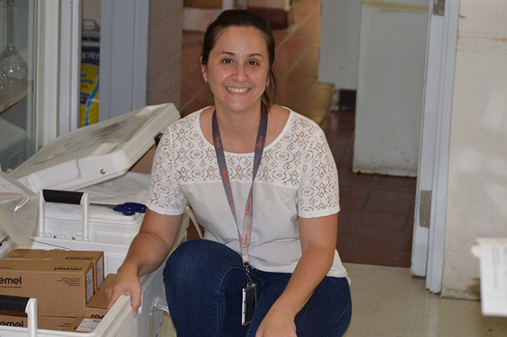 ; public health scientist Jeniffer Concepción-Acevedo unpacks supplies