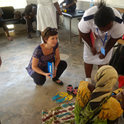 Katie Curran (EISO, WDPB) interviews a patient admitted in a Cholera Treatment Center in Dar es Salaam, during the 2015 – 2016 Tanzania cholera outbreak.