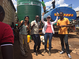CDC team cheering the arrival of chlorinated water during a cholera outbreak after a day of finding only empty tanks.