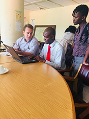 Drs. Bill Davis (EISO, WDPB) and Grace Appiah (Epidemiologist, WDPB), reviewing surveillance data with a colleague from the Ministry of Health.