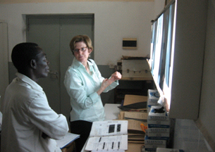 MAP Team member, Captain Mary Naughton, reviews chest x-rays with a panel physician in Ghana.