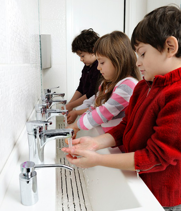 Children washing their hands at school.