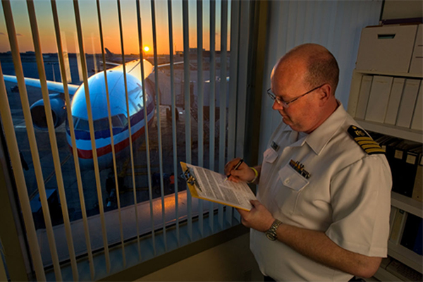 Quarantine officer at an airport reviewing data collected from an airline contact investigation. Image courtesy Greg Knobloch.