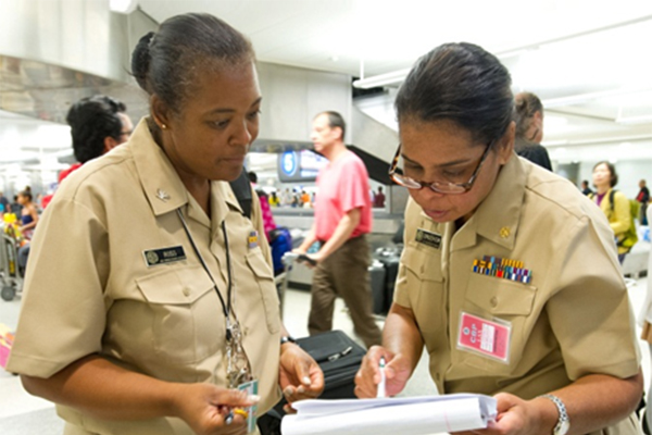 Keysha Ross and Kimberly Crocker, public health officers at the Los Angeles Quarantine Station, review flight information.