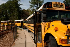 School buses waiting to take children home. When a flu pandemic occurs, public health officials may recommend nonpharmaceutical interventions such as temporary school dismissal.