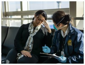 A CDC public health officer responds to a sick international traveler who just arrived in Los Angeles. Photo credit to Kenta Ishii, CDC.