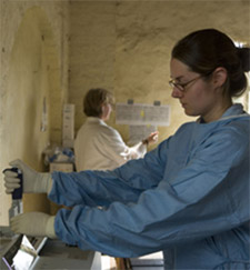 Woman wearing protective clothing in a medical facility