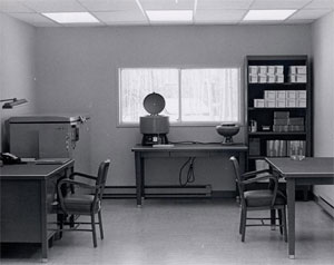 A black and white image an exam room in the Arctic Investigations Program's previous building.