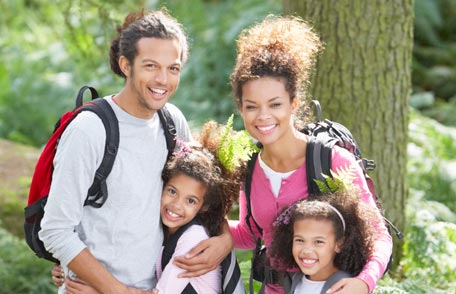 Family of four outdoors