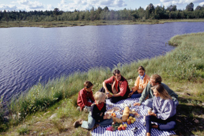 People having a picnic by the water