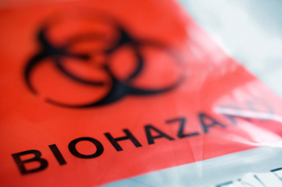 Close-up image of biohazard bag with the traditional red label