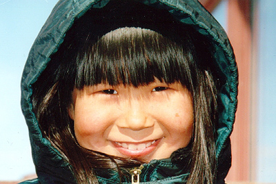 Link to What We Do - Image shows young girl in parka