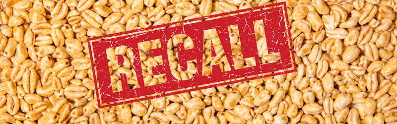 Image showing box of honey smacks cereal on a background of puffed wheat cereal
