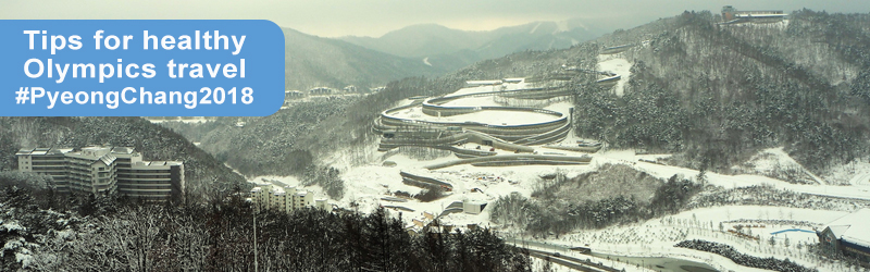 A landscape image of snowy hills prepared for the 2018 winter olympics in Pyeong Chang with the words: Tips for healthy Olympics travel